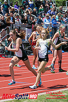 Anna West hits the brakes after handing the baton to Sarah Nicholson on their way to victory in the 4x800 at the 2016 MSHSAA Class 5 District 2 Track and Field Meet at Ladue High School, St. Louis, Saturday, May 14.