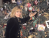 First lady Hillary Rodham Clinton shows off the 1994 White House Christmas Ornament in the Blue Room as she hosts a press event to preview the holiday decorations at the White House in Washington, D.C. on December 5, 1994.<br /> Credit: Ron Sachs / CNP