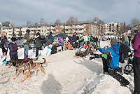 Kelly Maixner and team run past spectators on the bike/ski trail with an Iditarider in the basket during the Anchorage, Alaska ceremonial start on Saturday, March 5, 2016 Iditarod Race. Photo by O'Hara Shipe/SchultzPhoto.com