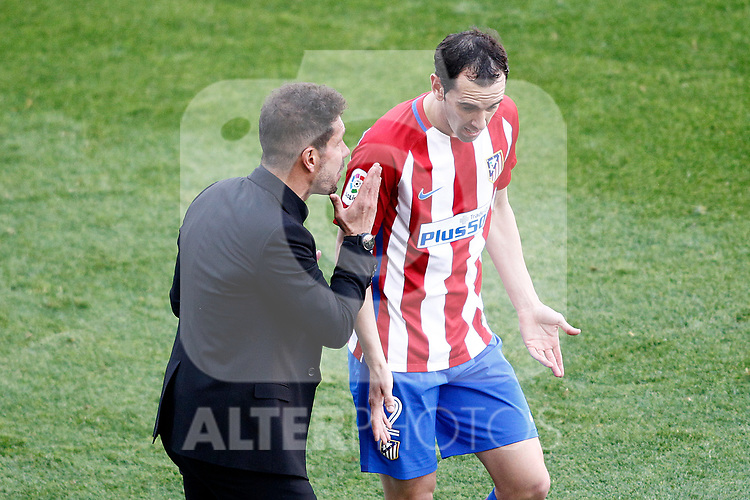 Atletico de Madrid's coach Diego Pablo Cholo Simeone (l) with Diego Godin during La Liga match. March 19,2017. (ALTERPHOTOS/Acero)