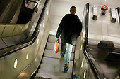 A man on an escalator at Westminster underground station.