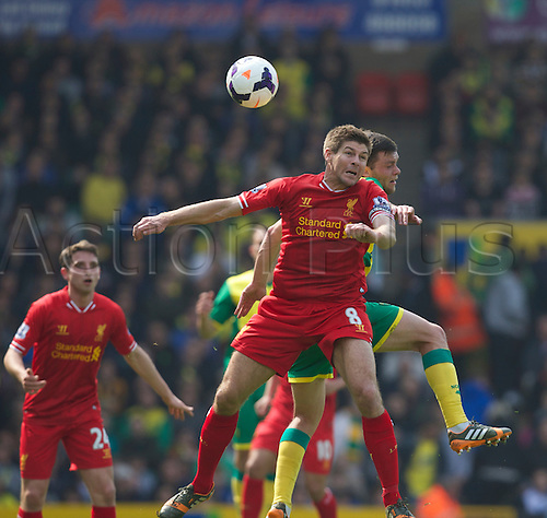 20.04.2014.  Norwich, England. Steven Gerrard of Liverpool wins the header during the Barclays Premier League match between Norwich City and Liverpool from Carrow Road.