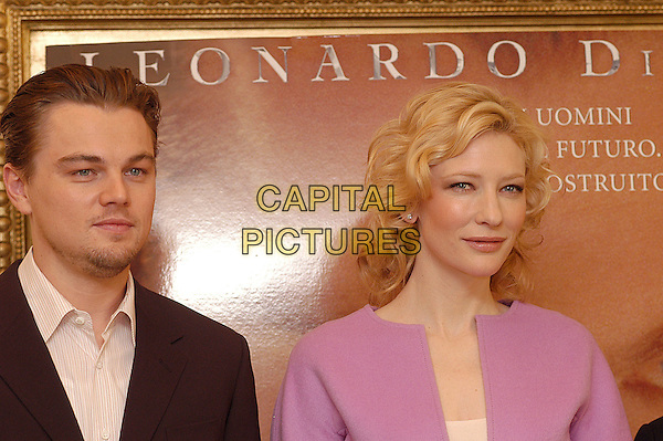 "LEONARDO DiCAPRIO & CATE BLANCHETT.Photocall for ""The Aviator"".Hotel Hassler, Rome, Italy, January 4th 2004.                      .portrait headshot pink dress coat jacket zip kate blanchet Di Caprio.Ref: LC.www.capitalpictures.com.sales@capitalpictures.com.©Luca Cavallari/Capital Pictures ."