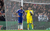 Goalkeeper Iker Casillas of FC Porto puts his arm round a frustrated Diego Costa of Chelsea during the UEFA Champions League group G match between Chelsea and FC Porto at Stamford Bridge, London, England on 9 December 2015. Photo by Andy Rowland.