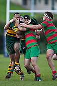 Baden Morey has support from Dominic Olson as he tries to stop Seremaia Tagicakibau. Counties Manukau Premier Club Rugby game between Pukekohe and Waiuku played at Colin Lawrie Fields, Pukekohe, on Saturday July 3rd 2010. Pukekohe won 31 - 12 after leading 15 - 9 at halftime.