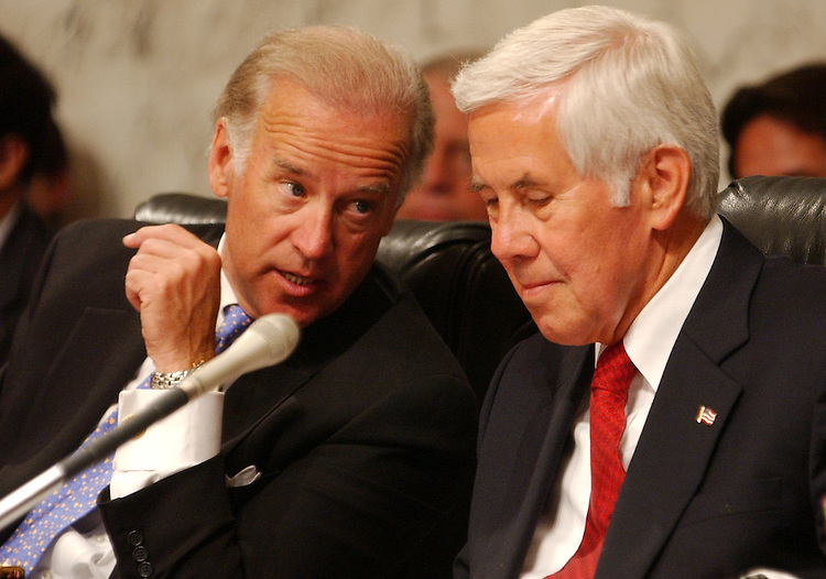 """lugar1/042903 -- Sens. Richard Lugar, R-Ind., right, and Joe Biden, D-Del., confer during an Senate Foreign Relations Committee on """"An Enlarged NATO: Mending Fences and Moving Forward on Iraq"""", in which Secretary of State Colin Powell, testified."""
