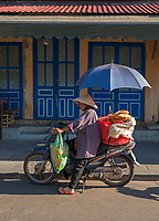Selling Baguettes; Old Town Hội An, the city's historic district, is recognized as an exceptionally well-preserved example of a South-East Asian trading port dating from the 15th to the 19th century and is a world UNESCO heritage Site.