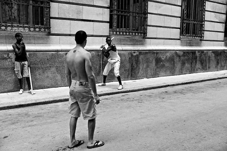 Images from the old Havana, Cuba.  ..Beisball it's the national sport of Cuba.  You see a lot more people playing it on the street, than you will see a soccer ball.  ..They have come up with many interpretations of how to play beisball in close counters.  In this case, with a small bat and a plastic cover as the ball.  Pitching consists of a sophisticated technique using the thumb and the index finger.  Not much running involve in this version of the sport.
