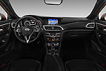 Stock photo of straight dashboard view of 2016 Infiniti Q30 Premium 5 Door Hatchback Dashboard
