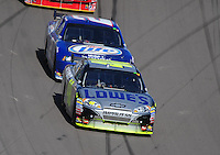 Mar. 1, 2009; Las Vegas, NV, USA; NASCAR Sprint Cup Series driver Jimmie Johnson leads Kurt Busch during the Shelby 427 at Las Vegas Motor Speedway. Mandatory Credit: Mark J. Rebilas-