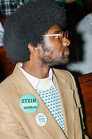 Khury Petersen-Smith, 34, of Boston, listens as Green Party presidential nominee Jill Stein speaks at a campaign rally at Old South Church in Boston, Massachusetts, on Sun., Oct. 30, 2016. Petersen-Smith was at the event handing out information about the International Socialist Organization. He is a supporter of Jill Stein.