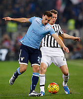Calcio, Serie A: Lazio vs Juventus. Roma, stadio Olimpico, 4 dicembre 2015.<br /> Lazio&rsquo;s Stefan Radu, left, and Juventus&rsquo; Stephan Lichsteiner fight for the ball during the Italian Serie A football match between Lazio and Juventus at Rome's Olympic stadium, 4 December 2015.<br /> UPDATE IMAGES PRESS/Riccardo De Luca