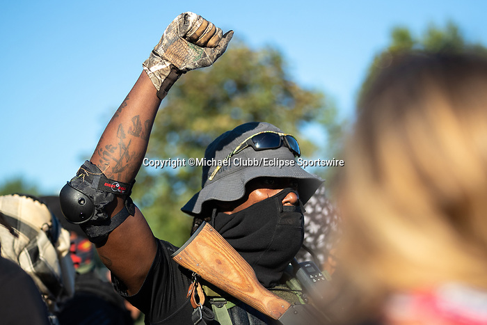 """September 5, 2020: A member of the NFAC holds up a fist outside of Churchill Downs  the 146th Kentucky Derby.  With the Kentucky Derby being the biggest sports event for the State of Kentucky, protestors have chosen the  event as a focal point for their calls for justice in the death of Breonna Taylor. Multiple groups from around the country have converged on Louisville to protest during the """"Run for the Roses"""" at Churchill Downs in Louisville. Michael Clubb/Eclipse Sportswire/CSM"""