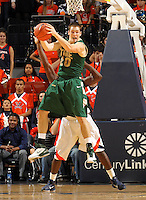 Nov. 12, 2010; Charlottesville, VA, USA; William & Mary Tribe g-f Quinn McDowell (20) gets the rebound in front of Virginia Cavaliers guard K.T. Harrell (24) during the game at the John Paul Jones Arena. Virginia won 76-52.  Photo/Andrew Shurtleff