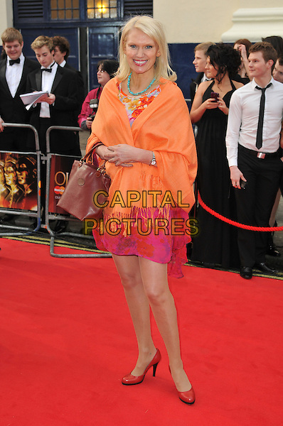ANNEKA RICE.Attending The Laurence Olivier Awards, .Theatre Royal, Drury Lane, London.England, UK, March 13th 2011..arrivals full length red shoes orange wrap shawl pink dress bag .CAP/CAS.©Bob Cass/Capital Pictures.