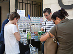 People waiting to purchase lottery tickets from a street seller, Seville, Spain