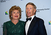 Morton Funger, right, and his wife, Norma Lee, arrive for the formal Artist's Dinner honoring the recipients of the 42nd Annual Kennedy Center Honors at the United States Department of State in Washington, D.C. on Saturday, December 7, 2019. The 2019 honorees are: Earth, Wind & Fire, Sally Field, Linda Ronstadt, Sesame Street, and Michael Tilson Thomas.<br /> Credit: Ron Sachs / Pool via CNP