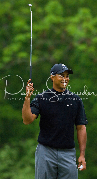 Tiger Woods smiles prior to hitting a putt during the 2007 Wachovia Championships at Quail Hollow Country Club in Charlotte, NC.