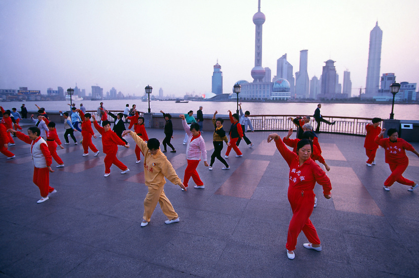 Early Morning Exercisers In Huangpu Park Pudong In Background