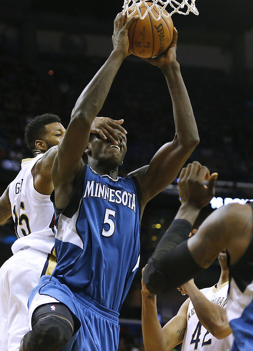 Minnesota Timberwolves center Gorgui Dieng (5) is fouled by New Orleans Pelicans forward Alonzo Gee (15) during the second half of an NBA basketball game Saturday, Feb. 27, 2016, in New Orleans. The Timberwolves won 112-110. (AP Photo/Jonathan Bachman)