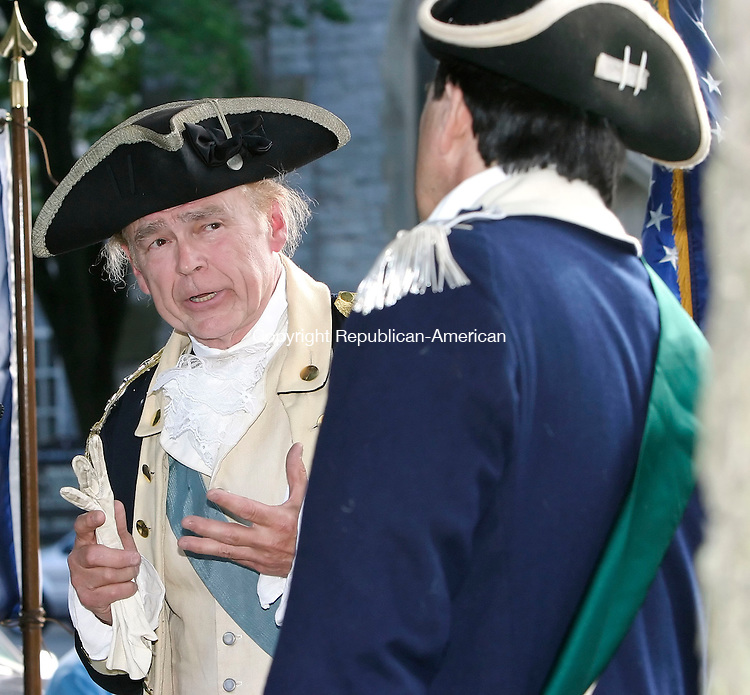 WATERBURY, CT, 15 June 2006- 061506B03- , General George Washington, played by Hugh Francis, of Greenville, NY, left, talks with Lt. Col. Harrison, aide de camp to Gen. Washington, played by Thomas Sephen, of New Canaan, CT,  about &quot;News From The Warfront; The French Connection&quot; on the green in Waterbury during the kick-off event for the Rochambeau weekend.<br /> Jamison C. Bazinet Republican-American