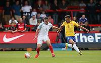 Lewis Cook (AFC Bournemouth) of England & Maycon of Brazil during the International match between England U20 and Brazil U20 at the Aggborough Stadium, Kidderminster, England on 4 September 2016. Photo by Andy Rowland / PRiME Media Images.