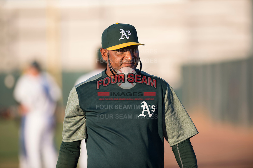 AZL Athletics pitching coach Gabriel Ozuna (39) before an Arizona League game against the AZL Giants Orange at Lew Wolff Training Complex on June 25, 2018 in Mesa, Arizona. AZL Giants Orange defeated the AZL Athletics 7-5. (Zachary Lucy/Four Seam Images)