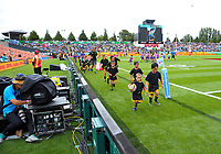 Rippa rugby players run past World Rugby photographer Mike Lee (left). Day one of the 2018 HSBC World Sevens Series Hamilton at FMG Stadium in Hamilton, New Zealand on Saturday, 3 February 2018. Photo: Dave Lintott / lintottphoto.co.nz