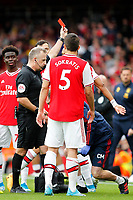 RED CARD - Referee, Jonathan Moss sends off Ainsley Maitland-Niles of Arsenal during the Premier League match between Arsenal and Aston Villa at the Emirates Stadium, London, England on 22 September 2019. Photo by Carlton Myrie / PRiME Media Images.