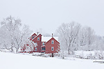A red farm on a snowy day in Hollis, NH, USA