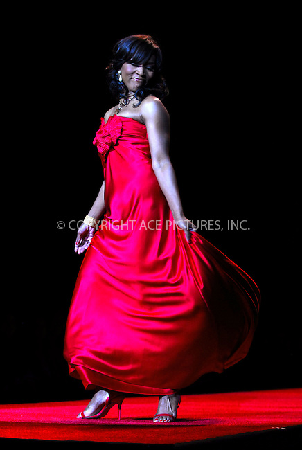 WWW.ACEPIXS.COM . . . . . ....February 2, 2007. New York City.....Angela Bassett wearing Carmen Marc Valvo during Heart Truth Red Dress Collection Fall 2007.....Please byline: KRISTIN CALLAHAN - ACEPIXS.COM.. . . . . . ..Ace Pictures, Inc:  ..(212) 243-8787 or (646) 679 0430..e-mail: picturedesk@acepixs.com..web: http://www.acepixs.com
