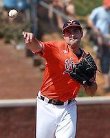 Virginia pitcher Whit Mayberry (47) throws to first base during the game against Clemson Sunday at Davenport Field in Charlottesville, VA. Photo/Daily Progress/Andrew Shurtleff