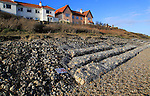 Gabion steel cages containing rocks form coastal defences at Thorpeness, Suffolk, England, UK