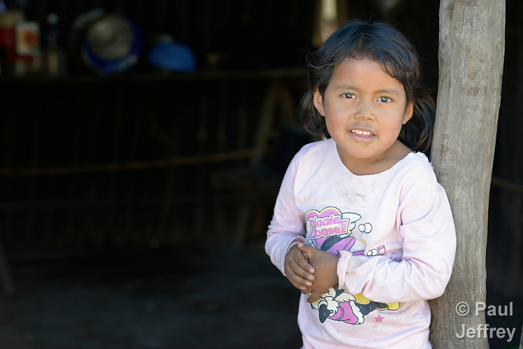 Soli Marita, a 3-year old Wichi indigenous girl, at home in Lote 75, an indigenous neighborhood of Embarcacion, Argentina. The Wichi in this area, largely traditional hunters and gatherers, have struggled for decades to recover land that has been systematically stolen from them by cattleraisers and large agricultural plantations.
