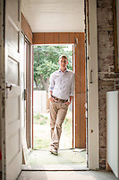 Nick Steele at his new home in the Cole neighborhood in Denver, Colorado, Friday, August 21, 2015.  Steele, who currently lives in Boulder, just purchased the older duplex and is planning to move in after remodeling.<br /> <br /> Photo by Matt Nager
