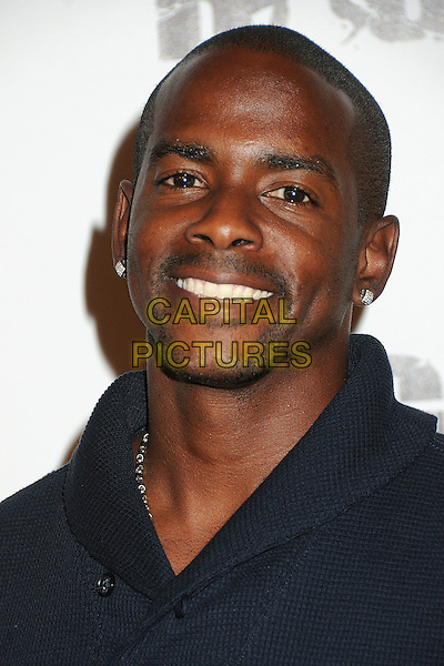 "Keith Robinson.""Rage"" Video Game Launch Party held in Chinatown's Historical Central Plaza, Los Angeles, California, .30th September 2011..portrait headshot smiling .CAP/ADM/BP.©Byron Purvis/AdMedia/Capital Pictures."