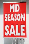 Mid season sale sign
