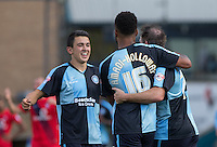 Luke O'Nien (left) of Wycombe Wanderers runs to celebrate Wycombe third goal with Aaron Amadi Holloway (centre) of Wycombe Wanderers and Garry Thompson of Wycombe Wanderers during the Sky Bet League 2 match between Wycombe Wanderers and York City at Adams Park, High Wycombe, England on 8 August 2015. Photo by Andy Rowland.
