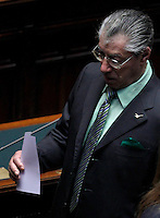 Il presidente della Lega Nord Umberto Bossi vota durante la sesta seduta comune di senatori e deputati per l'elezione del nuovo Capo dello Stato, alla Camera dei Deputati, Roma, 20 aprile 2013..Northern League president Umberto Bossi votes during the sixth common plenary session of senators and deputies to elect the new Italy's Head of State, at the Lower Chamber in Rome, 20 April 2013..UPDATE IMAGES PRESS/Isabella Bonotto