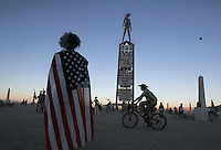 "BLACK ROCK CITY,NV - AUGUST 28,2008: View of the Burning Man as the sun sets August 28,2008. The theme for Burning Man in 2008 is "" The American Dream"". The event, which culminates with the burning of large installation art over the weekend, attracts over 30,000 people annually."