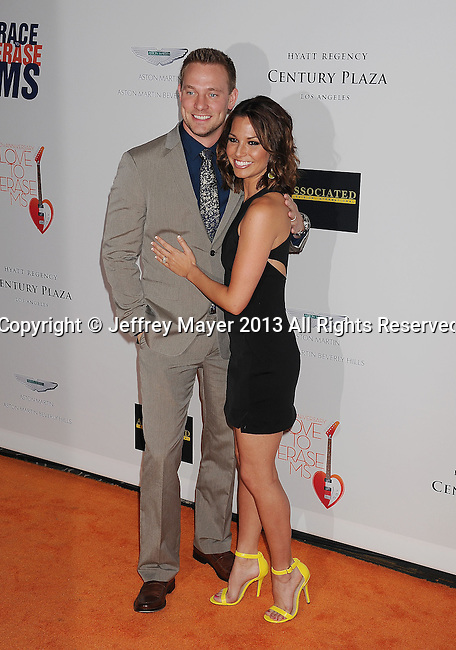 CENTURY CITY, CA- MAY 03: Tye Strickland and TV Personality Melissa Rycroft-Strikland arrive at the 20th Annual Race To Erase MS Gala 'Love To Erase MS' at the Hyatt Regency Century Plaza on May 3, 2013 in Century City, California.