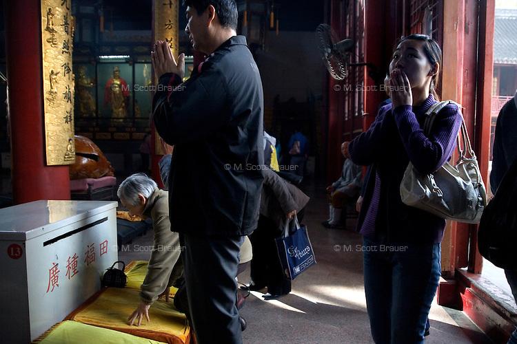Buddhists worship at the Qixia Temple outside Nanjing, China.