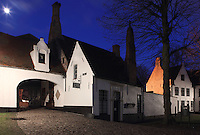 BRUGES, BELGIUM - FEBRUARY 07 : A low angle view of a Beguine's house by night, with a sparkling moon in the dark blue sky on February 07, 2009 in Bruges, Western Flanders, Belgium. The 'Beguinage of the Vineyard' was founded in the first half of the 13th century during the reign of Margaret of Constantinople. (Photo by Manuel Cohen)