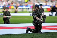 Servicemen take their positions on the pitch prior to the match. MasterCard Trophy International match between England and the Barbarians on May 30, 2010 at Twickenham Stadium in London, England. [Mandatory Credit: Patrick Khachfe/Onside Images]