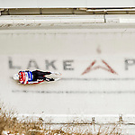 5 December 2015: Erin Hamlin, competing for the United States of America, slides through Curve 10 on her second run of the Viessmann World Cup Women's Luge. With a combined 2-run time of 1:27.961 and a track record on her first run, Hamlin takes the first place finish at the Olympic Sports Track in Lake Placid, New York, USA. Mandatory Credit: Ed Wolfstein Photo *** RAW (NEF) Image File Available ***