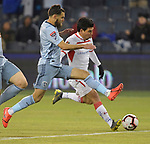 Graham Zusi (left) of Sporting KC vies for the ball with Luis Mendoza of Toluca during their CONCACAF Champions League game on February 21, 2019 at Children's Mercy Park in Kansas City, KS.<br /> Tim VIZER/Agence France-Presse