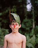 PERU, Amazon Rainforest, South America, Latin America, portrait of Asa with a bird costume made of leaves and flowers.