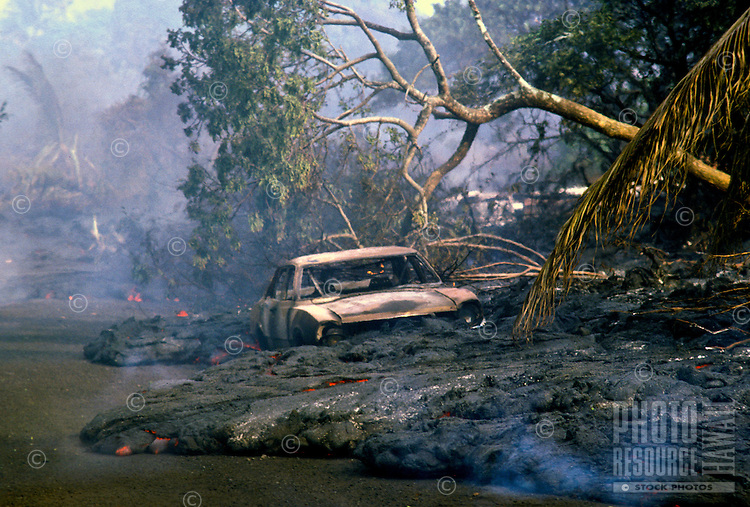 Old car embedded in lava flow at Hawaii volcanoes national park, Big island