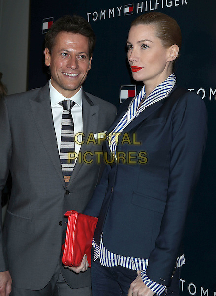 Ioan Gruffudd, Alice Evans.Tommy Hilfiger West Coast Flagship Grand Opening Event, West Hollywood, California, USA, .13th February 2013 ..half length grey gray suit tie blue striped white shirt red clutch bag couple husband wife .CAP/ADM/RE.©Russ Elliot/AdMedia/Capital Pictures.