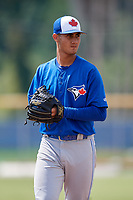 Toronto Blue Jays relief pitcher Juan Acosta (69) gets ready to deliver a pitch during a Florida Instructional League game against the Pittsburgh Pirates on September 20, 2018 at the Englebert Complex in Dunedin, Florida.  (Mike Janes/Four Seam Images)
